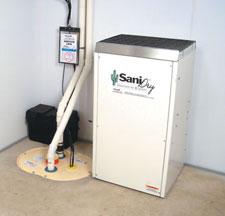 sump pump installation contractors in ohio installing a sump pump